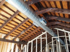 exposed spiral ducts (into master bath).