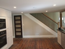 stairway to the midlevel, and door to pantry. (the door is original to the barn).
