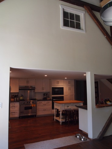 from the dining room, looking into the kitchen. (mid-level bedroom is above with the interior window.)