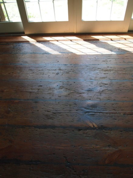 the dining room floors, after the sanding, wood-fill and matte poly.